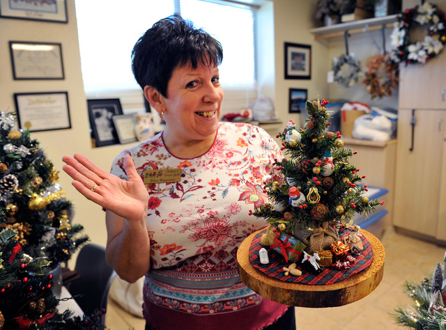 Elise Rigatuso displays a holiday arrangement that will be for sale at the 40th annual Holiday Boutique at the Children's Service Guild workshop at Child Haven in Las Vegas on Friday, Sept. 26, 20 ...