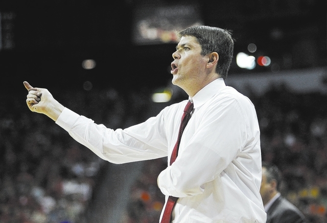 UNLV head coach Dave Rice yells instructions to his players while taking on San Diego State during their Mountain West basketball tournament semi-final game at the Thomas & Mack Center in Las Vega ...