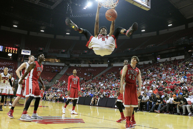 UNLV forward Christian Wood dunks during the annual Scarlet and Gray scrimmage, Thursday, Oct. 16, 2014, at the Thomas & Mack Center. (Sam Morris/Las Vegas Review-Journal)