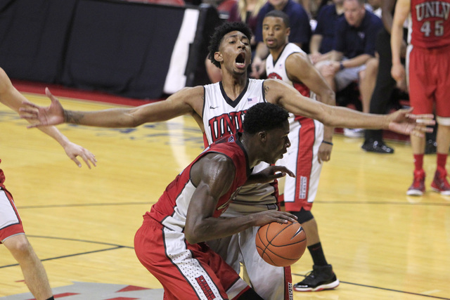 UNLV forward Christian Wood reacts while defending forward Goodluck Okonoboh during the annual Scarlet and Gray scrimmage, Thursday, Oct. 16, 2014, at the Thomas & Mack Center. (Sam Morris/Las Veg ...