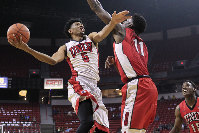 UNLV forward Christian Wood is defended by forward Goodluck Okonoboh during the annual Scarlet and Gray scrimmage Thursday, Oct. 16, 2014 at the Thomas & Mack Center. (Sam Morris/Las Vegas Review- ...