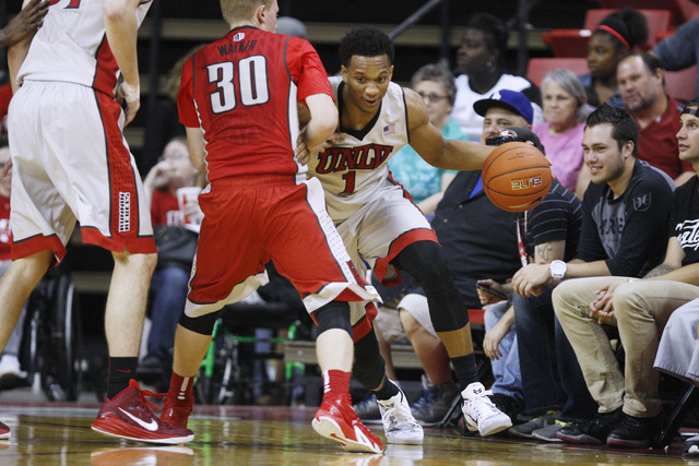 UNLV guard Rashad Vaughn drives around guard Dantley Walker during the annual Scarlet and Gray scrimmage, Thursday, Oct. 16, 2014, at the Thomas & Mack Center. (Sam Morris/Las Vegas Review-Journal)
