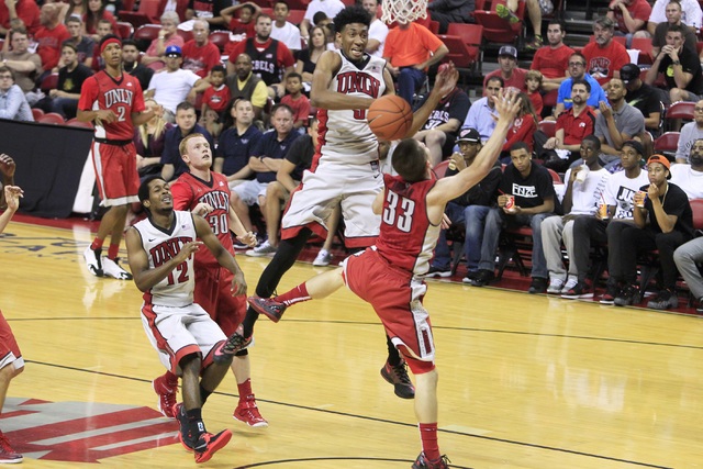 UNLV forward Christian Wood swats a shot away from guard Charles Rushman during the annual Scarlet and Gray scrimmage Thursday, Oct. 16, 2014 at the Thomas & Mack Center. (Sam Morris/Las Vegas Rev ...