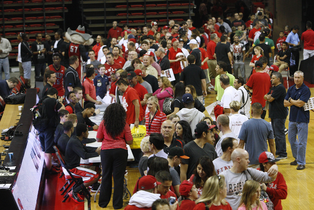 UNLV fans line up for autographs during the annual Scarlet and Gray scrimmage, Thursday, Oct. 16, 2014, at the Thomas & Mack Center. (Sam Morris/Las Vegas Review-Journal)