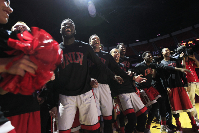 UNLV players react to a teammate's dance moves during introductions for the annual Scarlet and Gray scrimmage, Thursday, Oct. 16, 2014, at the Thomas & Mack Center. (Sam Morris/Las Vegas Review-Jo ...