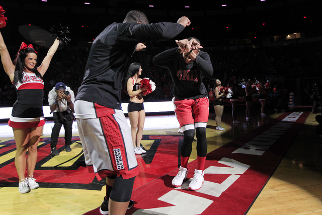 UNLV guards Jordan Cornish, left, and Jelan Kendrick show off their dance moves during the annual Scarlet and Gray scrimmage, Thursday, Oct. 16, 2014, at the Thomas & Mack Center. (Sam Morris/Las  ...