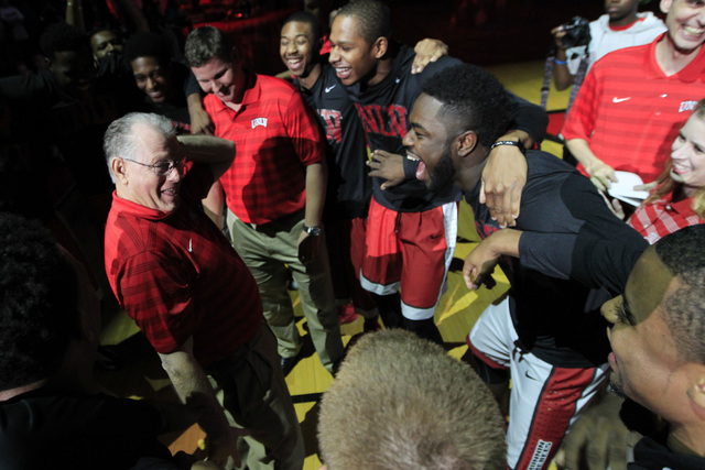 Players react as UNLV special assistant to the head coach Max Good dances in the huddle during the annual Scarlet and Gray scrimmage, Thursday, Oct. 16, 2014, at the Thomas & Mack Center. (Sam Mor ...