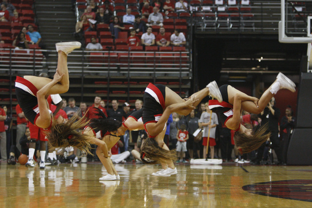 UNLV cheerleaders perform during the annual Scarlet and Gray scrimmage, Thursday, Oct. 16, 2014, at the Thomas & Mack Center. (Sam Morris/Las Vegas Review-Journal)