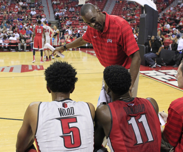 UNLV assistant coach Stacey Augmon talks with forwards Christian Wood and Goodluck Okonoboh during the annual Scarlet and Gray scrimmage, Thursday, Oct. 16, 2014, at the Thomas & Mack Center. (Sam ...