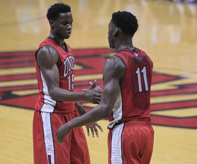 UNLV forward Dwayne Morgan, left, and Goodluck Okonoboh slap hands during the annual Scarlet and Gray scrimmage, Thursday, Oct. 16, 2014, at the Thomas & Mack Center. (Sam Morris/Las Vegas Review- ...