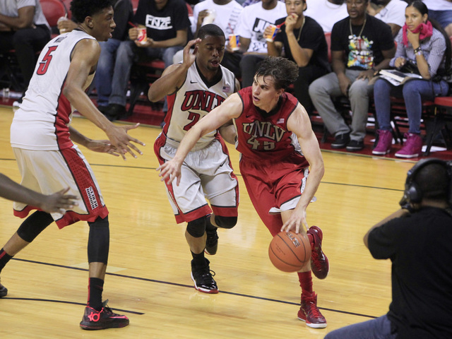 UNLV guard Cody Doolin drives past guard Jerome Seagears during the annual Scarlet and Gray scrimmage, Thursday, Oct. 16, 2014, at the Thomas & Mack Center. (Sam Morris/Las Vegas Review-Journal)