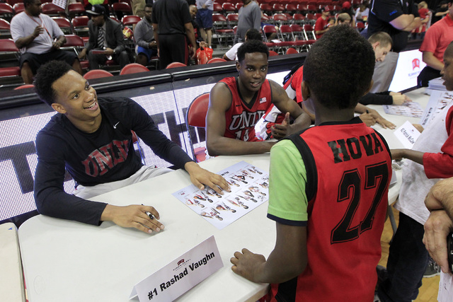 UNLV guard Rashad Vaughn, left, and forward Dwayne Morgan sign autographs during the annual Scarlet and Gray scrimmage, Thursday, Oct. 16, 2014, at the Thomas & Mack Center. (Sam Morris/Las Vegas  ...
