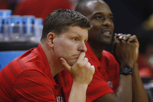 UNLV assistant coaches Ryan Miller, left, and Stacey Augmon watch their players during the annual Scarlet and Gray scrimmage, Thursday, Oct. 16, 2014, at the Thomas & Mack Center. (Sam Morris/Las  ...