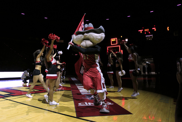 UNLV mascot Hey Reb runs a flag out during the annual Scarlet and Gray scrimmage, Thursday, Oct. 16, 2014, at the Thomas & Mack Center. (Sam Morris/Las Vegas Review-Journal)
