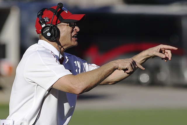 UNLV Rebels head football coach Bobby Hauck shouts instructions to his players at Sam Boyd Stadium in Las Vegas, Nov. 3, 2012. (Jason Bean/Las Vegas Review-Journal)