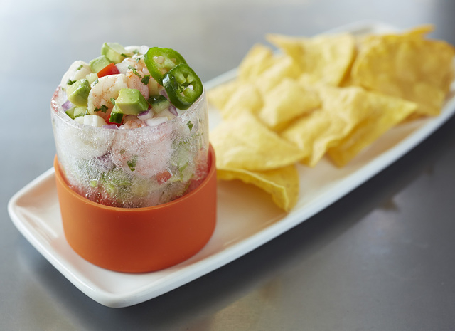 Cold Snap Fresh Ceviche, chilled baby scallops, shrimp, fresh fish and vegetables served in a glass made of ice, is on the appetizer menu at Bonefish Grill. (Special to View)