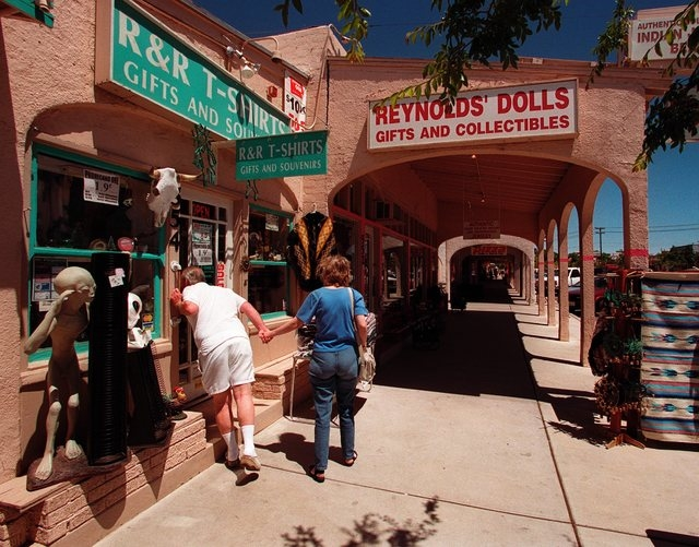 A couple window shop on Nevada Way in downtown Boulder City, June 20, 2001. Part of Nevada Way downtown has a small town-old west feel, featuring covered walkways that help beat the summer heat. ( ...