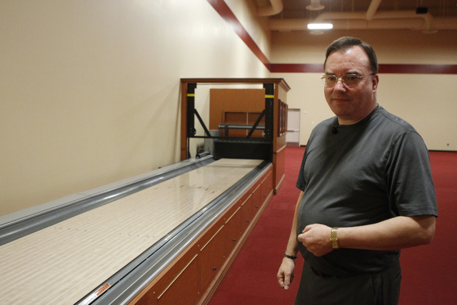 Director of bowling operations Mike Monyak stands next to a bowling lane that will be equipped with a camera to take photos of bowlers competing at the new South Point Bowling Plaza at South Point ...