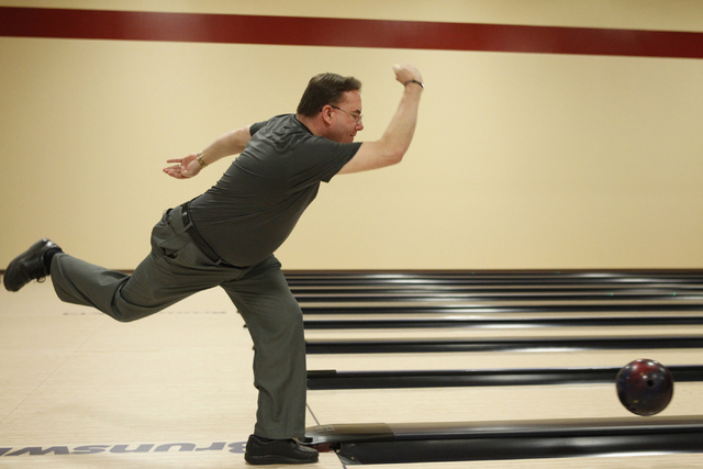 Director of bowling operations Mike Monyak bowls at the new South Point Bowling Plaza at South Point casino-hotel in Las Vegas Wednesday, Oct. 22, 2014. (Erik Verduzco/Las Vegas Review-Journal)