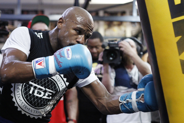 Floyd Mayweather Jr. works out with a punching bag at his gym, Mayweather Boxing Club in Las Vegas, during a media event Tuesday, Sept. 2, 2014. Mayweather hosted the event in anticipation of his  ...