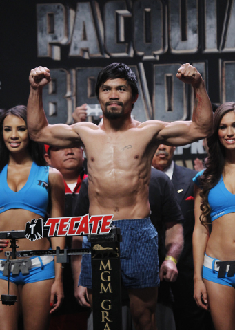 Boxer Manny Pacquiao poses while getting weighed in prior to his rematch against Timothy Bradley at the MGM Grand Garden Arena in Las Vegas on April 11, 2014. (Jason Bean/Las Vegas Review-Journal)