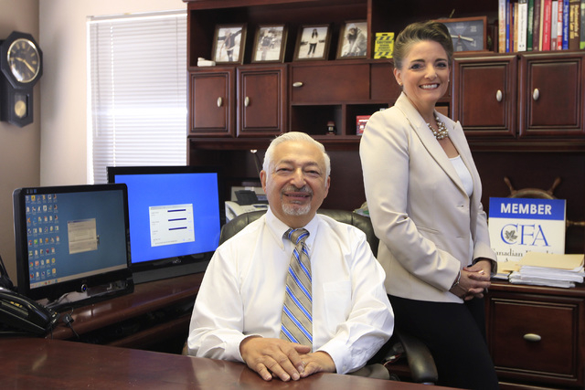 Jeff Nyman and his wife Linda Hentges-Nyman are seen at their First Choice Business Brokers Las Vegas office Tuesday, Oct. 21, 2014. (Sam Morris/Las Vegas Review-Journal)