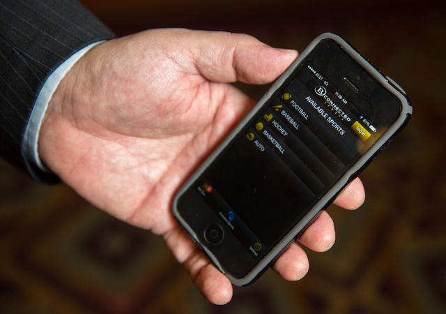 Bob Scucci, Boyd Gamingճ director of race and sports books, holds his phone launched with B Connected Sports, a sports wagering application for mobile devices, at The Orleans Friday, Sept. 2 ...