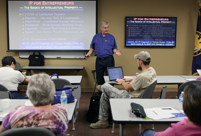 Norman Brown, center, certified business mentor, gives instruction during an Intellectual Property Basics for Entrepreneurs: Patents, Copyrights, Trademarks & Trade Secrets seminar at SCORE Saturd ...