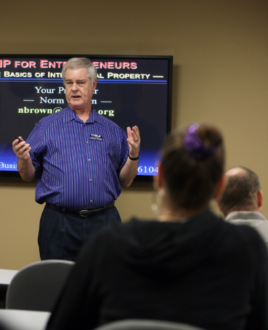 Norman Brown, left, certified business mentor, gives instruction during an Intellectual Property Basics for Entrepreneurs: Patents, Copyrights, Trademarks & Trade Secrets seminar at SCORE Saturday ...