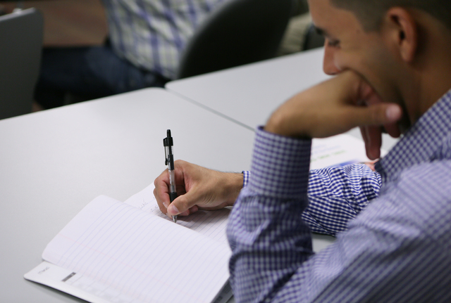 A participant takes notes during an Intellectual Property Basics for Entrepreneurs: Patents, Copyrights, Trademarks & Trade Secrets seminar at SCORE Saturday, Sept. 27, 2014, in Las Vegas. SCORE o ...