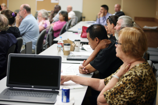 People attend an Intellectual Property Basics for Entrepreneurs: Patents, Copyrights, Trademarks & Trade Secrets seminar at SCORE Saturday, Sept. 27, 2014, in Las Vegas. SCORE offers small busines ...