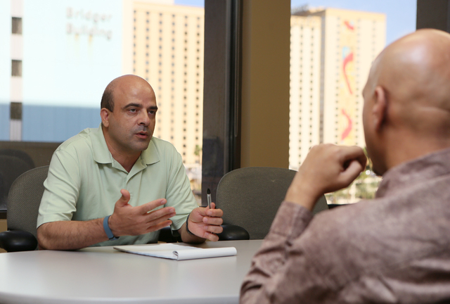 Entrepreneur Manuel Ramirez, left, speaks with certified business mentor Raj Tumber during an Intellectual Property Basics for Entrepreneurs: Patents, Copyrights, Trademarks & Trade Secrets semina ...