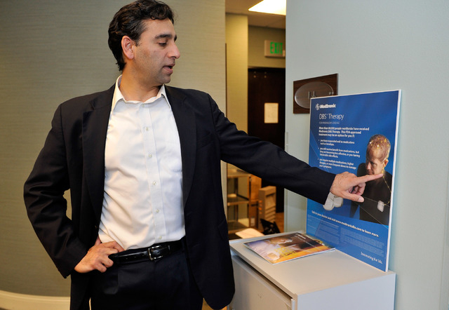 Neurosurgeon and spine specialist Dr. Aury Nagy explains his brain stimulation treatment at his Las Vegas office on Monday, Sept. 29, 2014. (David Becker/Las Vegas Review-Journal)