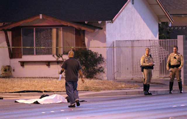 Las Vegas police investigate the scene of a fatal motorcycle crash on East Desert Inn Road near Pecos Road in Las Vegas on Monday, Oct. 27, 2014. Police said a vehicle turned onto Pecos in front o ...