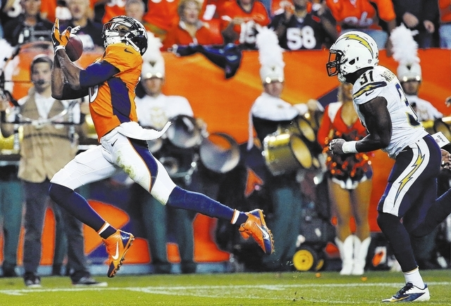 Denver Broncos wide receiver Emmanuel Sanders (10) pulls in a touchdown pass, in front of San Diego Chargers' Richard Marshall during the first half of an NFL football game, Thursday, Oct. 23, 201 ...