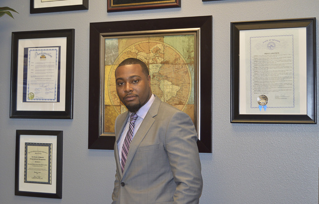 Devin Brooks poses in his Las Vegas office on Friday, Sept. 18, 2014. (Stephanie Annis/Special to the Business Press)