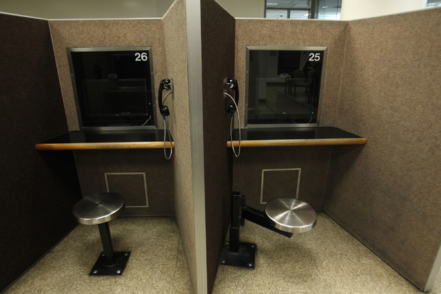Video screen booths are seen at the visitor lobby inside the Clark County Detention Center in Las Vegas during a tour Friday, Oct. 3, 2014. The booths allow visitors to speak to detainees using hi ...