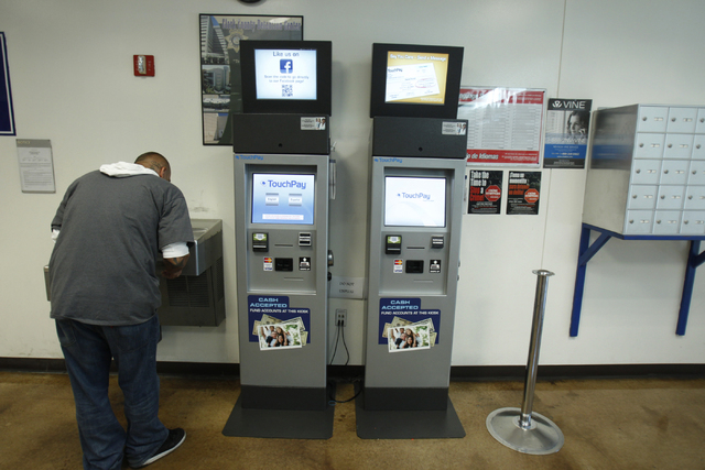 TouchPay kiosks are seen at the Clark County Detention Center visitor lobby in Las Vegas during a tour Friday, Oct. 3, 2014. The kiosks allow visitors to pay bail directly for detainees and add mo ...