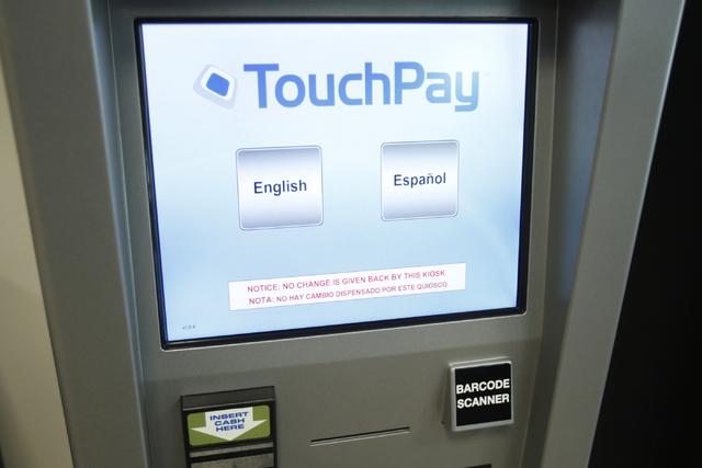 A TouchPay kiosk is seen at the Clark County Detention Center visitor lobby in Las Vegas during a tour Friday, Oct. 3, 2014. The kiosks allow visitors to pay bail directly for detainees and add mo ...