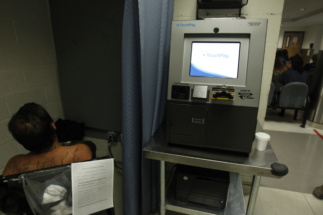 A TouchPay kiosk that allows officers to record money from booked detainees is seen in the pre-arrest area at the Clark County Detention Center in Las Vegas during a tour Friday, Oct. 3, 2014. The ...