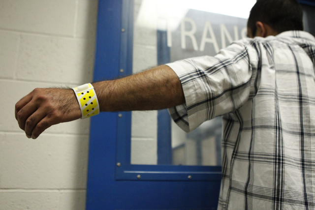 An inmate shows his wristband with his personal information at the Clark County Detention Center in Las Vegas Friday, Oct. 3, 2014. (Erik Verduzco/Las Vegas Review-Journal)