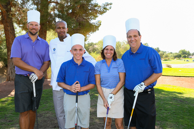 Rudy Ridenbaugh, left, CSN student chef Brandon Perry, Ethan Blankfeld, Helene Blankfeld and Harvey Blankfeld pose for a photo at last year's golf tournament to support Chefs for Kids program, Oct ...