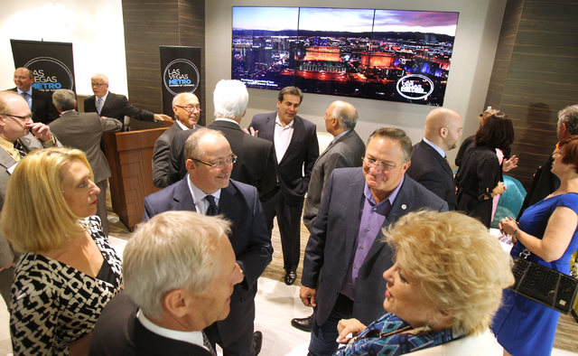 Las Vegas Metro Chamber of Commerce executives and elected officials mingle during a ribbon-cutting ceremony for the new Chamber offices at The Smith Center for the Performing Arts on Monday, Oct. ...