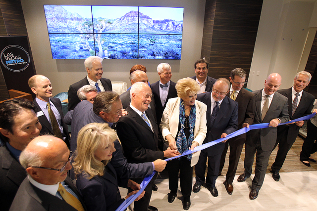 Las Vegas Metro Chamber of Commerce executives and elected officials pose during a ribbon-cutting ceremony for the new Chamber offices at The Smith Center for the Performing Arts on Monday, Oct. 2 ...