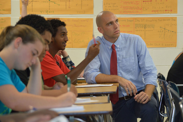 Brian Ellis, an algebra teacher, works with his students at First Coast High School, May 27, 2014. Ellis is a Jacksonville School Leadership Fellow, a Quality Education for All program that takes  ...