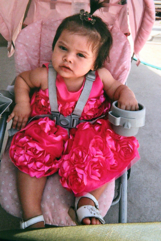 Michell Momox-Caselis, 16 months, who was killed in an apparent murder-suicide involving her foster father Sunday, is shown in this undated family photo made available to the Las Vegas Review-Jour ...
