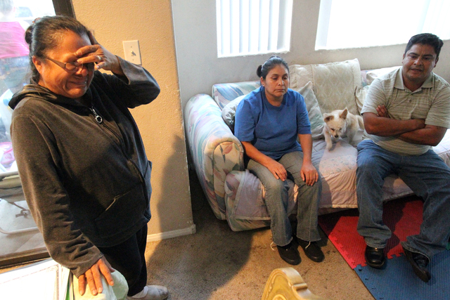 Nicolasa Robledo-Hernandez, left, former foster mother of 16-month-old Michell Momox-Caselis, and Michell's biological parents, Maria De Jesus Caselis Toxtle and Sergio Momox, talk to a reporter a ...