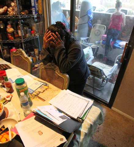 Nicolasa Robledo-Hernandez, former foster mother of 16-month-old Michell Momox-Caselis, cries while talking to a reporter at her Las Vegas apartment Friday, Oct. 17, 2014. Momox-Caselis  was taken ...