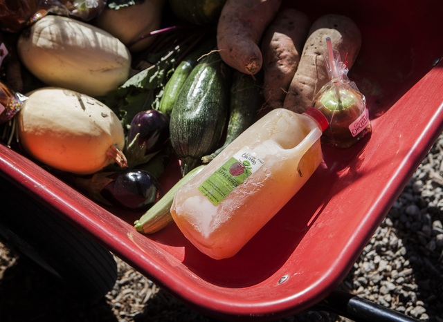 a wheelbarrow of vegetables including homemade apple cider available at Gilcrease Orchard, 7800 N. Tenaya Way, on Thursday, Oct. 9, 2014. The cider is made from apples at the orchard.  (Jeff Schei ...