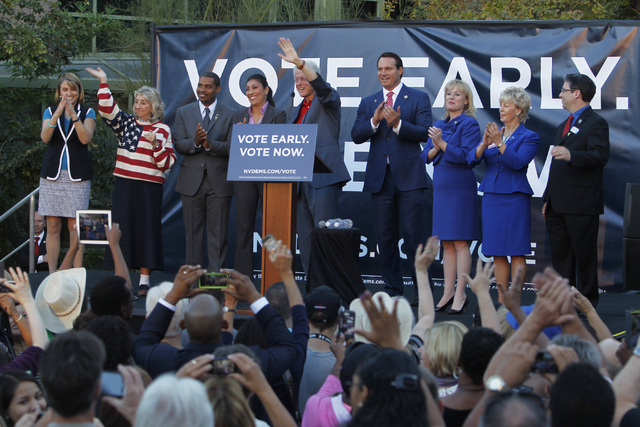 From left, Kate Marshall, Dina Titus, Steven Horsford, Lucy Flores, former President Bill Clinton, Ross Miller, Erin Bilbray, Kim Wallin and Andrew Martin wave to supporters after a Nevada Democra ...